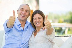 Couple smiling with thumbs up