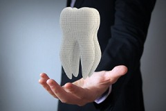 man holding digital tooth