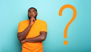 Man with orange question mark wonders about dental implants and bruxism