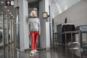 mature female passing through airport security